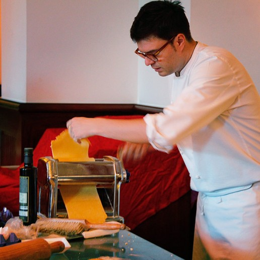 Chef Alessandro presses the dough